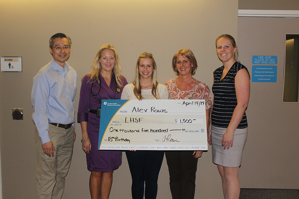 Alex Rowe presents large cheque to the Act Now program at LHSC.