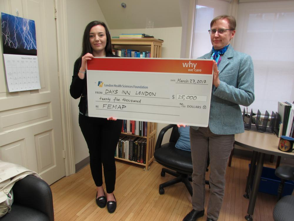 Devony Lescadres, Sales Manager, Days Inn London, presents a cheque for $25,000 to Dr. Beth Osuch