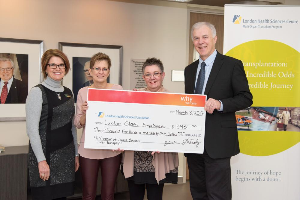 Transplant recipient Janice Corbin and her colleague Louise McNeely of Laxton Glass LLP present their law office's donation to LHSC's Deborah Kuhar and Dr. Anthony Jevnikar