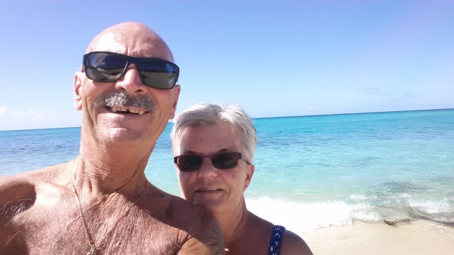 gord and his wife on the beach