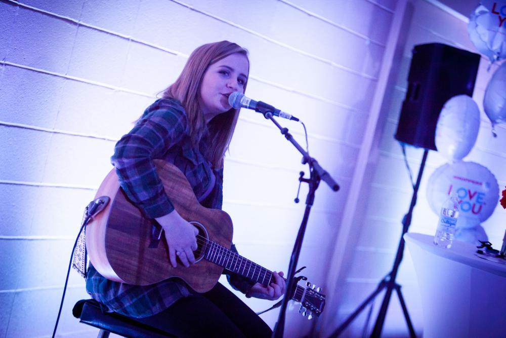 sarina haggarty performs on the guitar