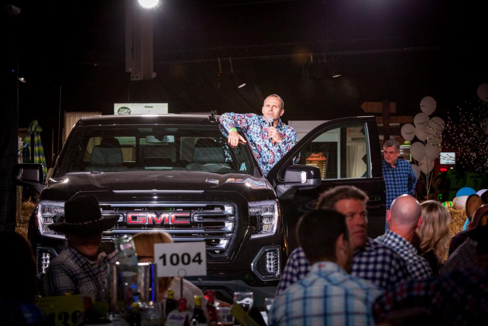 auctioneer in a truck